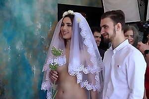 Nude bride clothed groom