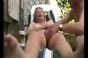 Granny having fun in court yard. Amateur older