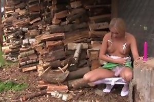 Pretty blonde girl in cute dress plays with her coochie outdoors