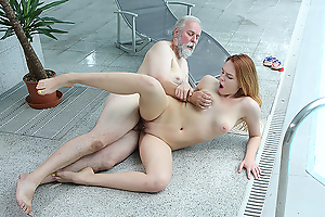 Cutie goes out of the pool to play with her pussy.