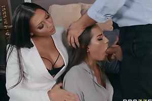Two glamorous brunettes pleasuring Keiran in bed